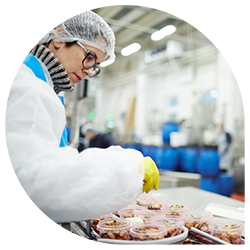Worker processing meat