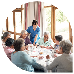 Caregiver talking with senior living residents